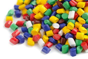 Сolourful plastic polymer granules on white